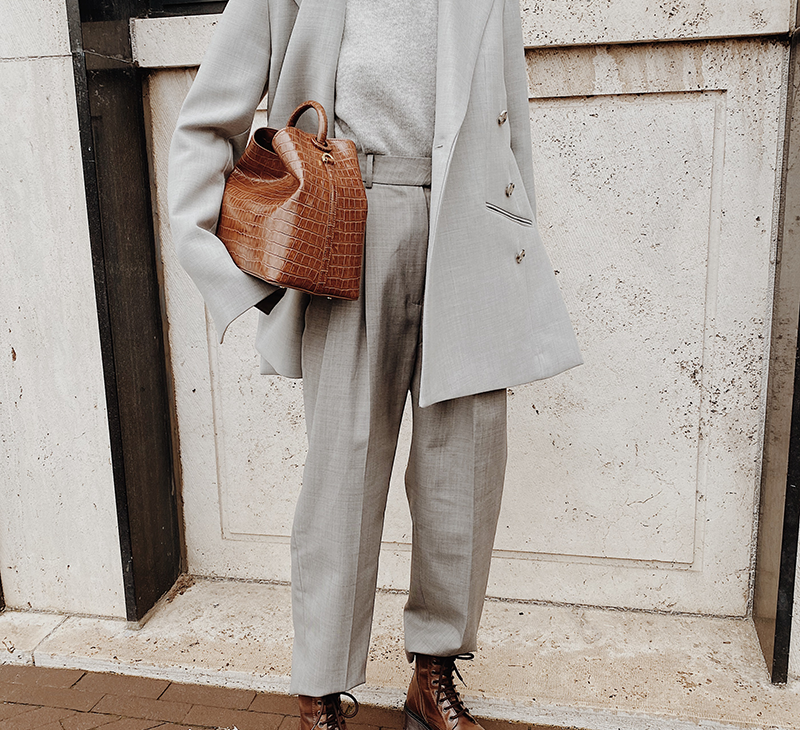 Woman in chic monochrome grey outfit